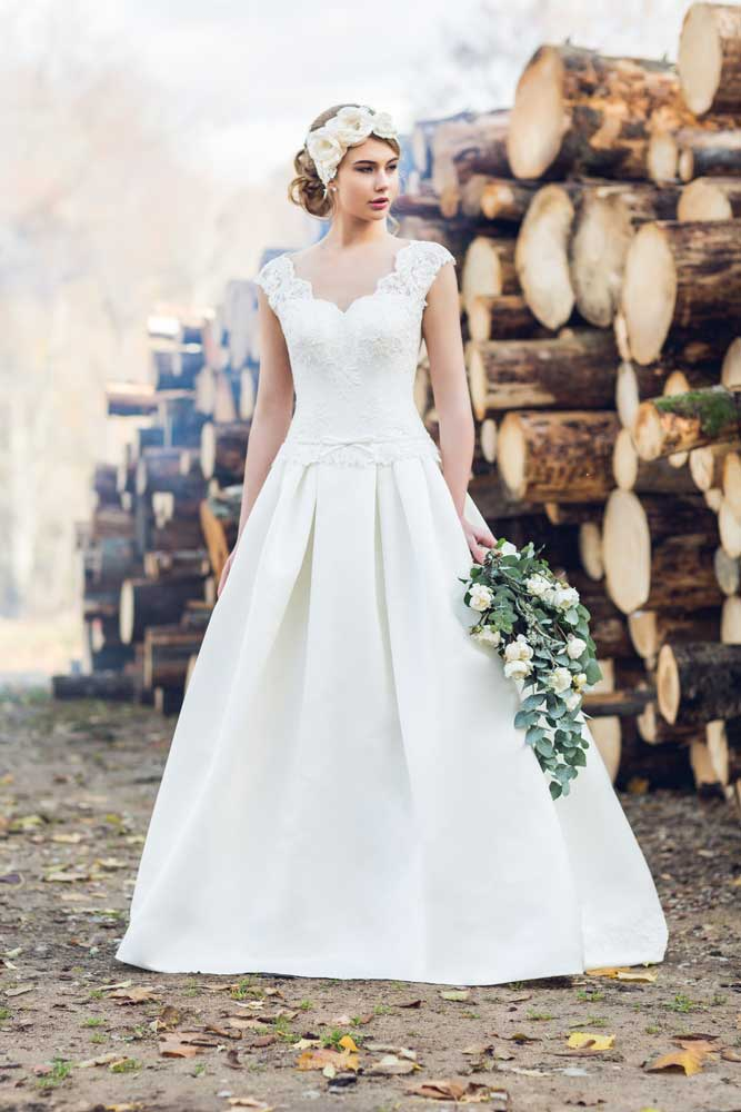 Plunging V Neck Wedding Gown With Tiered Skirt Imagine The Entrance You Ll